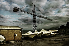 Safe and happy: again, I'm asking myself where are we going (Paolo Castronovo) Tags: panorama beach clouds landscape boat crane decay dragan hdr paesaggio canon450d