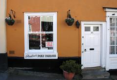 Lavenham, Suffolk - Pauline's Poky Parlour (streetr's_flickr) Tags: nikond70 lavenham suffolk medieval halftimber timberframedhouses pargeting paulinespokyparlour highstreet shopfront sashwindow ochre 93 doorway