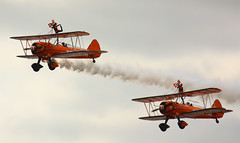Breitling Wingwalkers At Southend Air Show May 2011 (Feggy Art) Tags: breitling wingwalkers boeing stearman southend air show airshow 29 may 2011 aircraft airplane plane planes jet turbojet essex england aerobatic aviation aviator areoplane vapours vapors colours sky blue clouds vapour trail kiss x2 rebel xsi eos canon feggy art victius 450d
