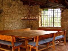 Mangia! (thrown_art (off + on for a bit)) Tags: wood old italy window candles meals rustic tuscany villa benches stonewalls lightfixture diningroomtable woodtable brickfloor tuscanvilla tableandbenches rusticvilla rusticdiningtable