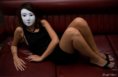 The shape of mystery °1° (Giuseppe Sapori) Tags: red portrait white black colors girl dark hair lights necklace nikon shoes shadows dress mask legs body flash sb600 sofa 1855 shape vignetting afs mistery dx d60 luminosity