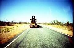 road train (Davide Rusconi) Tags: road park blue red sky colors yellow rock train lomo lca lomography bush long cross nation ct australia x iso saturation vehicle 100 uluru kata tjuta process lc agfa ayers northen territory precisa