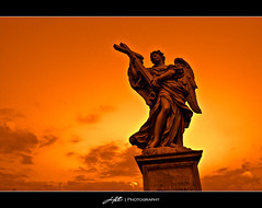 Red Sky Angel (HuTDoG83) Tags: sky italy sculpture orange rome roma art statue angel yahoo interestingness interesting nikon flickr italia vibrant orangesky redsky d40 nikond40 hutdog83