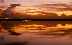 cloud wars (ssj_george) Tags: leica sunset red sky orange lake colors yellow night clouds reflections landscape lumix lights mirror airport rocks view purple nightshot sundown salt dramatic cyprus pole panasonic saltlake larnaca larnaka  georgestavrinos   fz38 fz35 ssjgeorge