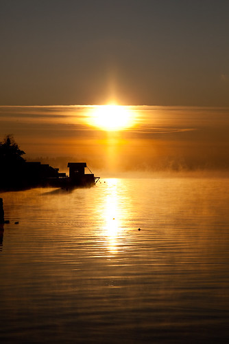 Sun rising over smoky water in Norway