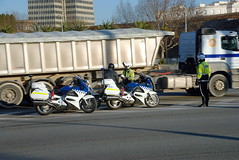 TRUCKING IN BARCELONA (Claude  BARUTEL) Tags: barcelona sea ferry port truck honda boat spain ship control harbour transport police motorcycle catalan trucking containers mediterranea