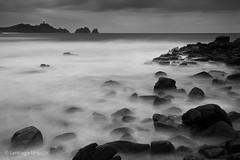20091227_12 (Zalacain) Tags: ocean longexposure sea blackandwhite lighthouse water night clouds landscape coast movement spain rocks cloudy dramatic galicia blackwhitephotos gettyimagesiberiaq2