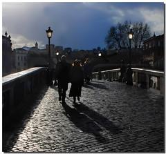 Among shadows and lights (Nespyxel) Tags: rome roma dark walking lights couple shadows streetlamp sunday atmosphere ponte trastevere atmosfera sampietrini controluce coppia buio pontesisto pave passeggiando bridgle nespyxel stefanoscarselli pleasedontusethisimageonwebsites blogsorothermediawithoutmyexplicitpermissionallrightsreserved