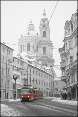 -Half past three- (Vt Hassan) Tags: winter red white snow black church three prague image watches half czechrepublic past tramway colouring selective tramwaj cathedralofstnicholas alwaysonlineatthishour