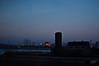 Darkest New Jersey (nosha) Tags: blue winter light sunset shadow orange usa reflection water beautiful beauty dark landscape 50mm march newjersey f14 apocalypse nj newark 50mmf14 2010 lightroom darkest blackmagic nosha 1320sec nikond40 1320secatf14