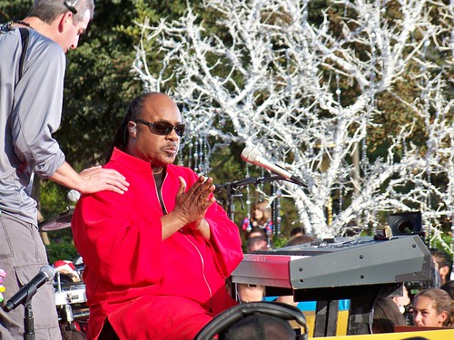 Stevie Wonder performs in front of Sleeping Beauty Castle for the Walt Disney World Christmas Special