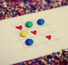 """Love is more than just a game for two"" (Love is the key) Tags: blue red game love colors yellow square fun 50mm is nice couple paint dof heart bokeh blu 14 lovers giallo smarties feeling non tris rosso bel cuore amore disegno  coppia gioco divertimento amanti sentimento"