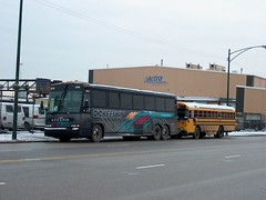 A size comparison of buses on South Canal Street. Chicago Illinois. January 2007.