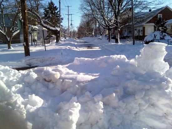 Snow Pile and Snowy Street