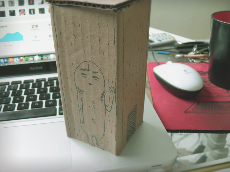 cardboard house with monster