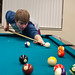 Students playing pool in the game room.