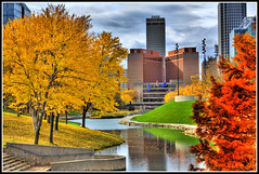 City Colors (jackaloha2) Tags: autumn trees lake fall water clouds stairs digital photoshop canon buildings reflections eos rebel nebraska cityscape fallcolors blues flags greens omaha yellows reds legacy changingcolors hdr pathway comment sincity xsi myhometown scyscrapers photomatrix mywinners miasbest daarklands legacyexcellence flickrvault trolledproud newgoldenseal