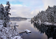 Last Winter, Down by the Bay (Peggy Collins) Tags: ocean christmas trees winter sea snow seascape canada clouds reflections landscape bay dock scenery peace view cloudy snowy britishcolumbia peaceful tranquility scene calm pacificocean pacificnorthwest vista tranquil penderharbour sunshinecoast christmascard snowytrees pristine winterscene theperfectphotographer peggycollins