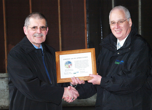 Caption - City of Shelton Mayor John Tarrant is presented with a certificate of appreciation by USDA Rural Development Washington State's Community Program Director Peter McMillin in recognition of the city's efforts to utilize the $28.8 million loan and grant in American Recovery and Reinvestment Act (ARRA) funds to upgrade the city's wastewater treatment plant.