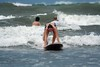 """Surfer standing up on her surfboard • <a style=""""font-size:0.8em;"""" href=""""https://www.flickr.com/photos/46837553@N03/4308559426/"""" target=""""_blank"""">View on Flickr</a>"""