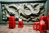 Chinese dragon and plastic chairs (deepstoat) Tags: street film zeiss 35mm temple dragon taiwan contaxg2 kodakportra deepstoat