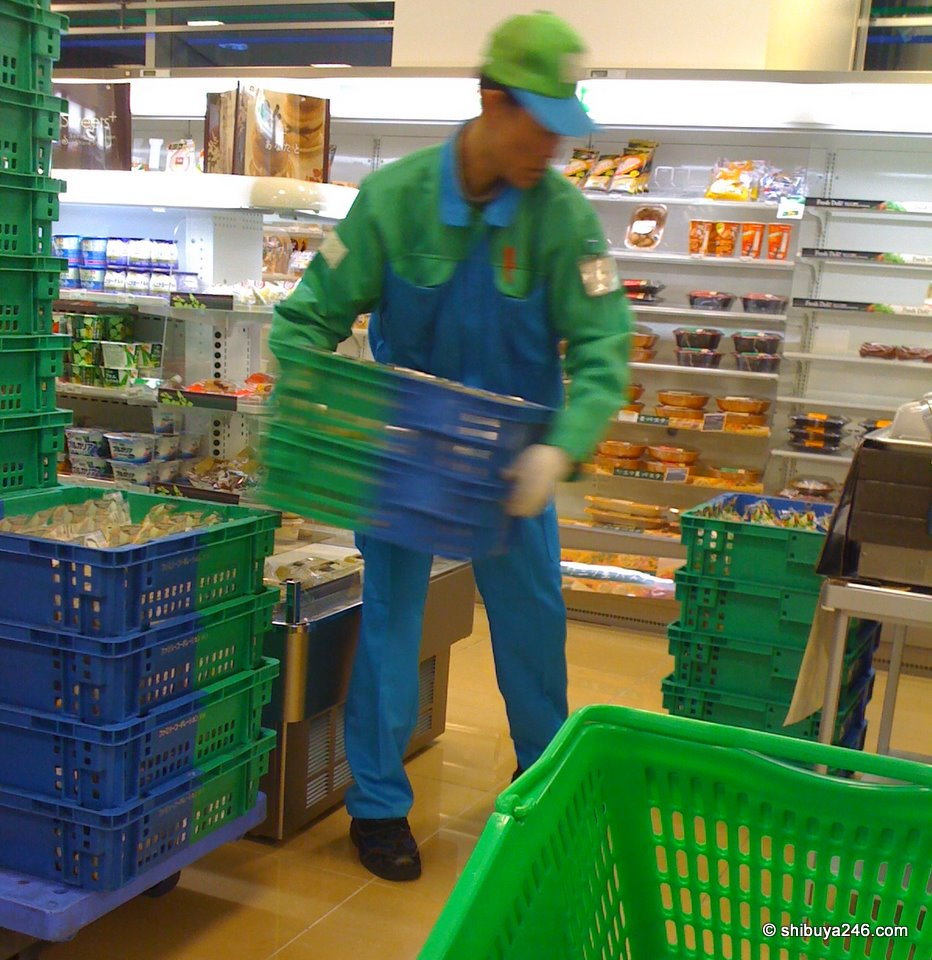 A Family Mart delivery man bringing in the fresh product to the store. Nice action shot here with the iPhone. Just the right amount of movement blur to be interesting.