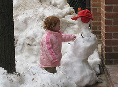 Speck fixes the neighbor's snowman, 24 months