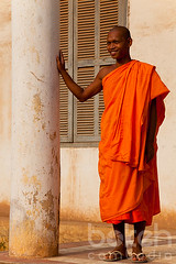 Monk resting on a column   Kandal Province, Cambodia (bokehcambodia) Tags: man building smile smiling wall architecture asian temple pagoda asia cambodia cambodian khmer robe religion colonial young monk buddhism weathered column wat oldbuilding saffron novice novicemonk saffronrobe frenchcolonial