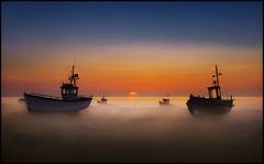 Still of the morning (adrians_art) Tags: mist beach fog sunrise dawn coast kent earlymorning bluesky shore dungeness fishingboats seawater