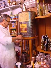 La Pizzicheria (Kat n Kim) Tags: italy food man shop market drum tuscany deli oliveoil toscana greve delicatessen weekendmarket tapping greveinchianti lapizzicheria