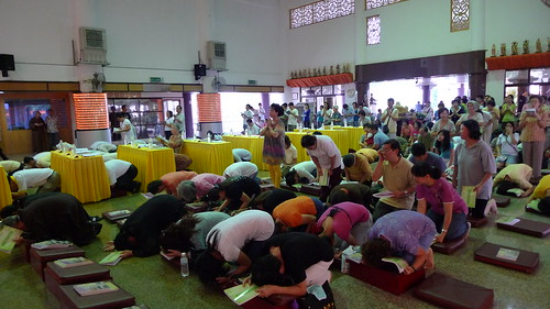 People bowing during Buddhist ceremony