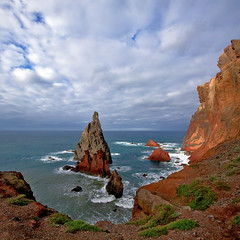 Madeira: Rough and Rugged... (Mr.Enjoy) Tags: ocean above blue red sea orange seascape color green portugal nature clouds walking landscape islands coast scenery rocks waves colours walk north perspective cliffs atlantic erosion ridge coastline geography rough isle madeira rugged vereda islets escarpment pontadesoloureno endure madeiraisland vertorama