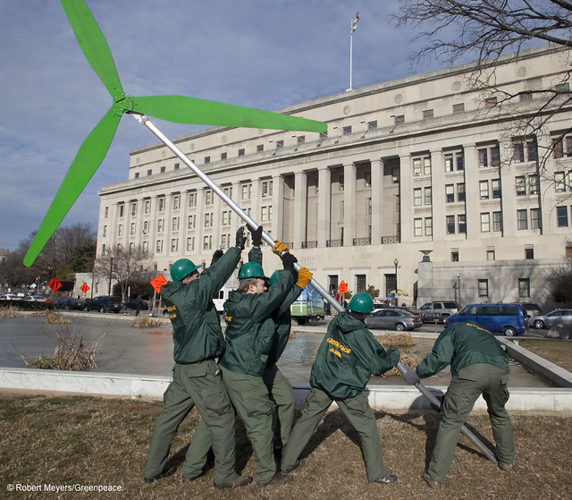 Greenpeace activists raise a wind turbine at the Department of the Interior during Cape Wind hearing