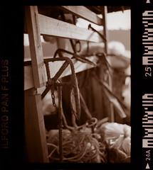 An anchor a weight (khai_nomore) Tags: bw 35mm fisherman jetty negative penang rm wideopen ilfordpanf50 2400dpi bayanlepas ilfordrapidfixer homedevelopment bokehlicious canonscan8400f autaut voigtlanderbessar3m noktonclassic40mmf14mc colourscanmode 2minstopbath tmaxdeveloper144minutes 26degresscelcius 6minutesfixer