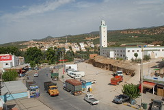 TRUCKING IN MOROCCO (Claude  BARUTEL) Tags: africa mountains sahara truck village desert mosque morocco atlas roads trucking berliet