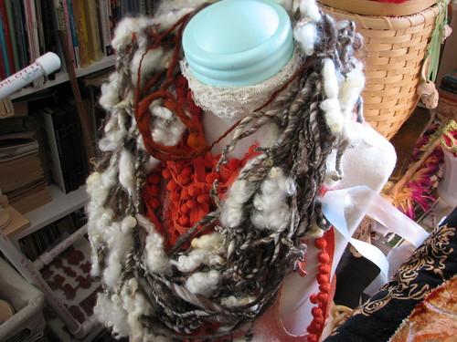 hand spun on dress form with pompoms