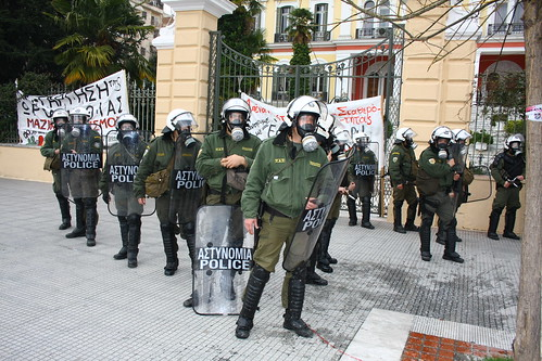 Greek riot police confront protesters outside government building