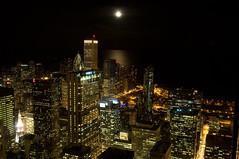 Moonrise Over Chicago (toast322) Tags: longexposure november moon chicago skyline architecture night loop lakemichigan moonrise 2009 prudentialbuilding aontower nikond90 firstnationalbankofchicago nikonafs1870mmf3545 thomasmkost
