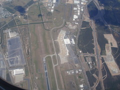 Aerial View Of International Terminal, Brisbane International Airport (BNE) (thienzieyung) Tags: above new city travel eye cars birds buildings airport construction view traffic aviation transport australia places brisbane terminal aeroplane aerial passengers roofs vehicles international 01 transportation queensland land geography runway clearing taxiway hangars bne jungles thresold