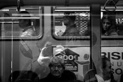 Splitting the atom (Donato Buccella / sibemolle) Tags: street people blackandwhite italy milan reflection self milano streetphotography tram bn massiveattack cairoli sciure canon400d sibemolle splittingtheatom selfinvolontario fotografiastradale
