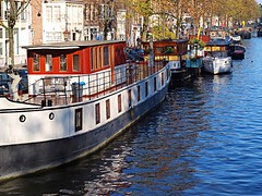 Amsterdam boats (dranidis) Tags: blue light red white holland water colors amsterdam reflections boat canal colorful thenetherlands houseboat olympus 43 dimitris fourthirds e520 zuiko1442mm olympuse520 gimp26 dranidis dimitrisdranidis