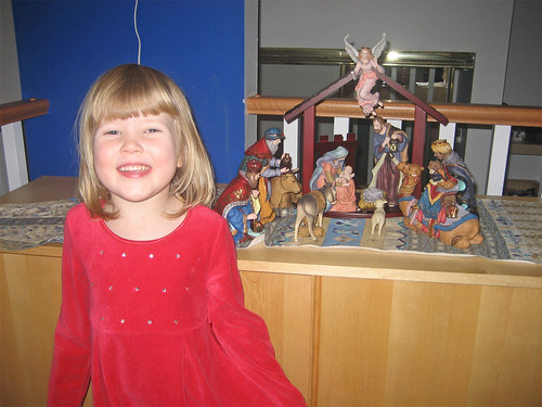 Hannah posing in front of the nativity scene