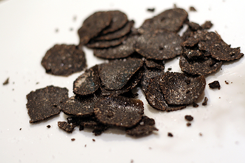 sliced black truffles with salt