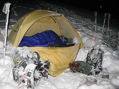 Snowy camp area. Carla tries to stay warm.