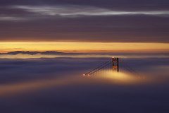 Golden Gate Sunrise - Day Two (maxxsmart) Tags: sanfrancisco california city longexposure day2 winter sky color fog clouds sunrise canon lights earlymorning hills explore goldengatebridge bayarea eastbay february 2010 congrats ef70200f4l lateforwork hawkhill tuesdaymorning nofilters crazybeautiful rollingfog twodaysinarow 5dmarkii morethanicansay