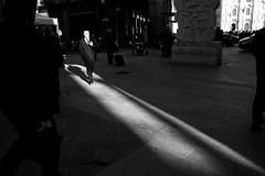 Last call for sun (Donato Buccella / sibemolle) Tags: street blackandwhite bw italy sun milan shadows candid milano streetphotography piazzadeimercanti canon400d sibemolle fotografiastradale