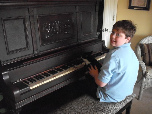 Logan giving LJ piano lessons