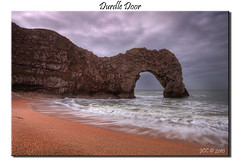 durdle door (Jerry Cartlidge) Tags: door sea clouds canon grey sand rocks waves slow cloudy sigma cliffs dorset coastline 1020mm hitech hdr durdle eos450d 09nd