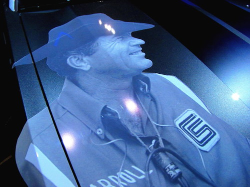 Portrait of Carroll Shelby on a Ford Mustang
