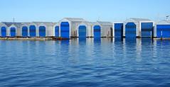 boatyard blues.. (leuntje) Tags: northvancouver bc britishcolumbia canada vancouver burrardinlet boatyard marina blue boathouses
